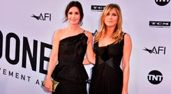 Courteney Cox (L) and Jennifer Aniston attend American Film Institute's 46th Life Achievement Award Gala Tribute to George Clooney at Dolby Theatre on June 7, 2018 in Hollywood, California. (Photo by Alberto E. Rodriguez/Getty Images for Turner )