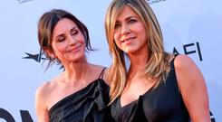 US actresses Courteney Cox (L) and Jennifer Aniston attends the 46th American Film Institute Life Achievement Award Gala at the Dolby Theatre in Hollywood on June 7, 2018. The American Film Institute (AFI) is honoring US actor George Clooney with the 46th AFI Life Achievement Award. / AFP PHOTO / VALERIE MACONVALERIE MACON/AFP/Getty Images
