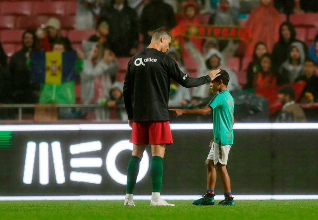 Portugal's Cristiano Ronaldo with his son after the match