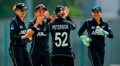 Amelia Kerr of New Zealand, lsecond left, is congratulated by team-mates after catching Mary Waldron of Ireland in the slips, during the Women's One Day International match between Ireland and New Zealand at the YMCA Cricket Club in Sandymount, Dublin. Photo by Seb Daly/Sportsfile