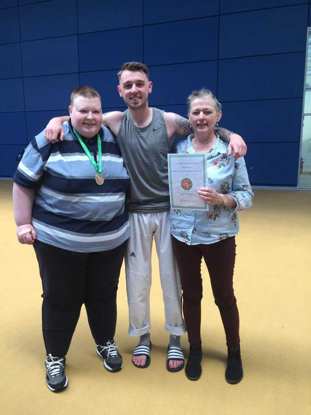 Colin (21), Conor (24) and their late mother Ann Grassick (53)
