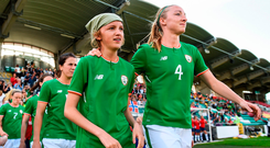 Ireland captain Louise Quinn leads out her team alongside matchday mascot Freya Fitzpatrick prior to World Cup qualifier against Norway. Photo by Stephen McCarthy/Sportsfile