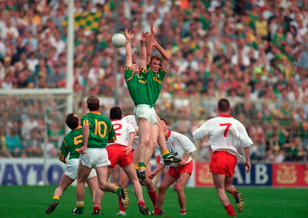 Colm Coyle (No 5 ) looks on as Meath pair Jimmy McGuinness and John McDermott contest a high ball in the 1996 All-Ireland semi-final. Picture credit; Brendan Moran / Sportsfile