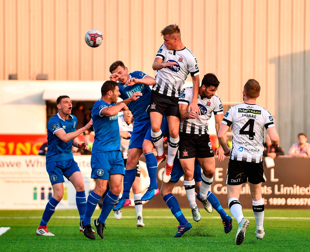Dundalk's Daniel Cleary rises highest with a header towards goal during their victory over Limerick at Oriel Park. Photo: Sam Barnes/Sportsfile
