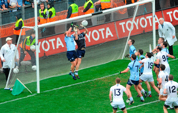 Shane Ryan and Dublin goalkeeper Stephen Cluxton combine to stop a late Kildare free in a dramatic end to the 2009 Leinster final.. Picture credit: Ray McManus / Sportsfile