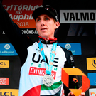 Ireland's Daniel Martin celebrates on the podium after winning the fifth stage of the Criterium du Dauphine cycling race. Photo: Getty Images