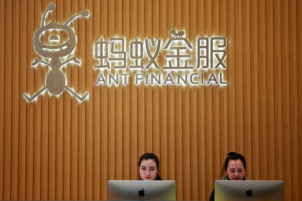 Employees at the reception desk of Ant Financial Services Group, Alibaba's financial affiliate, at its headquarters in Hangzhou, Zhejiang province, China. Photo: Reuters