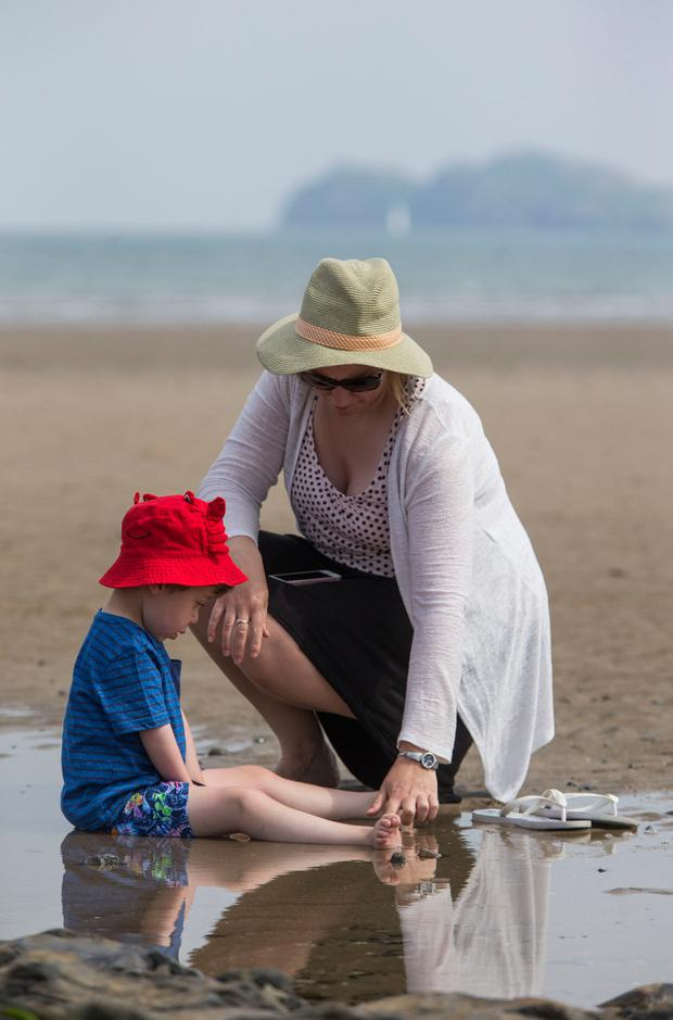 Cooling off from the summer sun with Mum at Portmanock Beach today. PIC COLIN O'RIORDAN