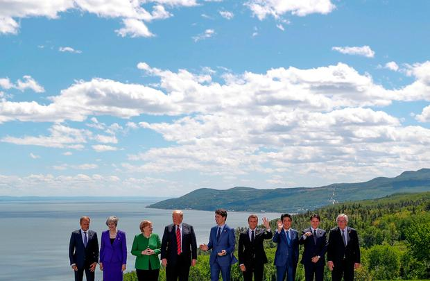 European Council President Donald Tusk, Britain's Prime Minister Theresa May, Germany's Chancellor Angela Merkel, U.S. President Donald Trump, Canada's Prime Minister Justin Trudeau, France's President Emmanuel Macron, Japan's Prime Minister Shinzo Abe, Italy's Prime Minister Giuseppe Conte and European Commission President Jean-Claude Juncker pose for a family photo at the G7 Summit in the Charlevoix city of La Malbaie, Quebec, Canada, June 8, 2018. REUTERS/Yves Herman TPX IMAGES OF THE DAY