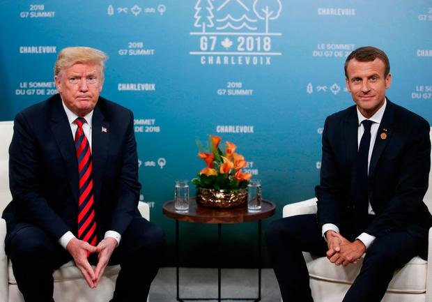 U.S. President Donald Trump sits side by side with France's President Emmanuel Macron during a bilateral meeting at the G7 Summit in Charlevoix, Quebec, Canada, June 8, 2018. REUTERS/Leah Millis