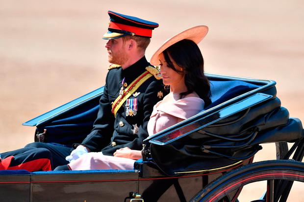 The Duke and Duchess of Sussex arrive at Horse Guards Parade, central London, during the Trooping the Colour ceremony, as the Queen celebrates her official birthday