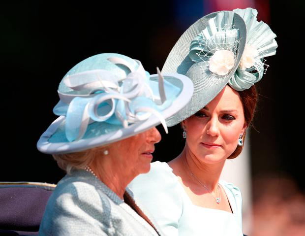 The Duchess of Cornwall (left) and the Duchess of Cambridge leave Buckingham Palace, central London on their way to Horse Guards Parade, ahead of the Trooping the Colour ceremony, as the Queen celebrates her official birthday