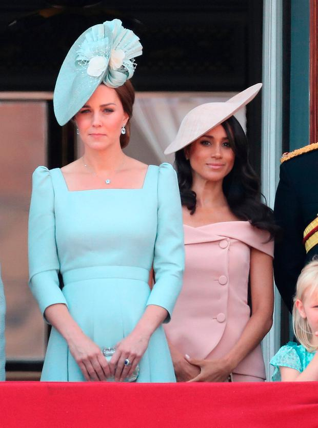 Catherine, Duchess of Cambridge and Meghan, Duchess of Sussex on the balcony of Buckingham Palace during Trooping The Colour on June 9, 2018 in London, England