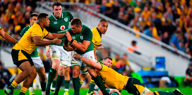 CJ Stander of Ireland is tackled by Scott Sio and David Pocock of Australia