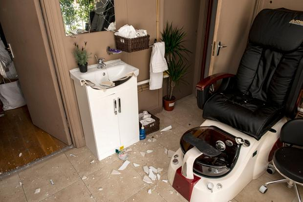 Damage caused by vandals inside the salon