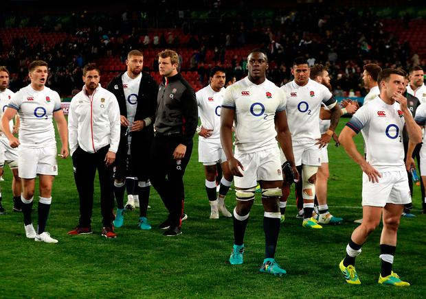 England's captain Owen Farrell, far left, stands dejected with teammates