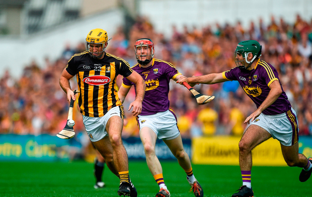 Colin Fennelly of Kilkenny in action against Diarmuid O'Keeffe, left, and Shaun Murphy of Wexford