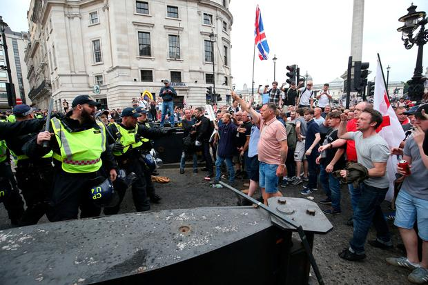 Police using batons hold back supporters of Tommy Robinson during their protest in Trafalgar Square, London calling for his release from prison. Jonathan Brady/PA Wire
