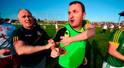 Meath manager Andy McEntee is restrained after confronting the referee