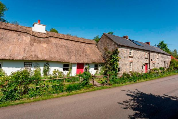 Mill Cottage comprises a thatched cottage and adjoining stone farmhouse.
