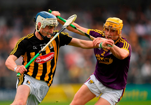 Luke Scanlon of Kilkenny in action against Damien Reck of Wexford