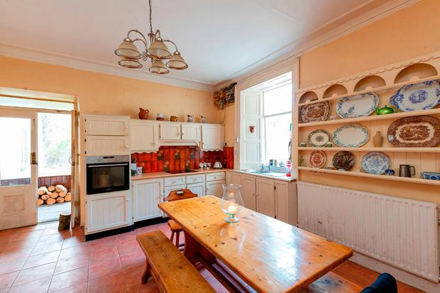The kitchen can be accessed from the garden room or the hallway and is to the rear of the house.
