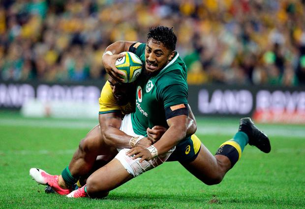 Ireland's Bundee Aki is tackled during the match against Australia. Photo:Tertius Pickard/AP