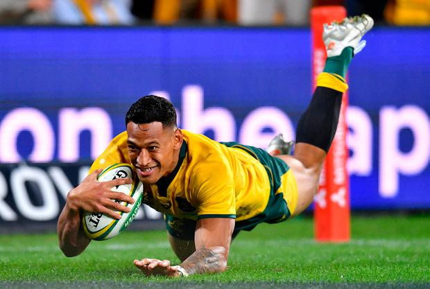 Israel Folau dives over to score a try for Australia. Photo: Darren England/Reuters