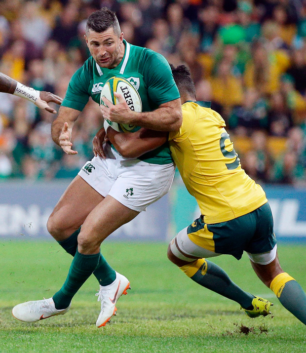Ireland's Rob Kearney is tackled by Australia's Will Genia. Photo: Tertius Pickard/PA