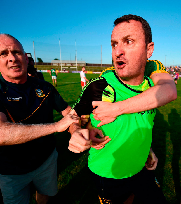 Meath boss Andy McEntee is restrained by his players after the final whistle. Photo: Sportsfile