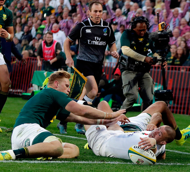 England's Mike Brown scores a try despite the attentions of South Africa's Jean-Luc du Preez. Photo: Themba Hadebe/AP