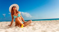 Many of us will bring a debit and/or a credit card to use on holiday, but we need to be careful that we do not end up getting singed in the sun by credit and debit card fees. (stock photo)