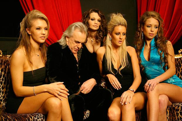 ZIP IT up: Peter Stringfellow at a photocall with some of the dancers from his Dublin club in 2006. Photo: Julien Behal