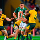 Jordi Murphy of Ireland is tackled by Kurtley Beale of Australia