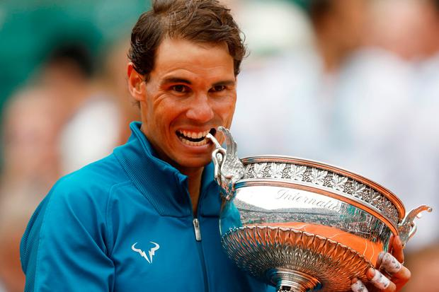 Spain's Rafael Nadal celebrates by biting the trophy