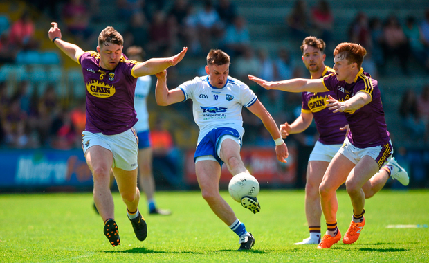 Gavin Crotty of Waterford in action against Naomhan Rossiter, left, and James Stafford of Wexford. Photo by Matt Browne/Sportsfile