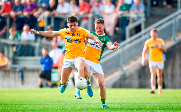 Patrick McBride of Antrim in action against Declan Hogan of Offaly. Photo by Sam Barnes/Sportsfile