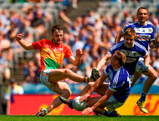 Diarmuid Walshe of Carlow in action against Damien O'Connor of Laois. Photo by Daire Brennan/Sportsfile