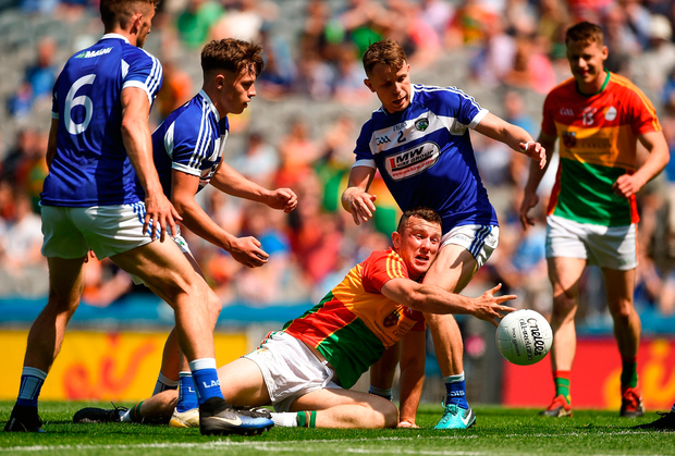 Darragh Foley of Carlow in action against Stephen Attride of Laois. Photo by Daire Brennan/Sportsfile