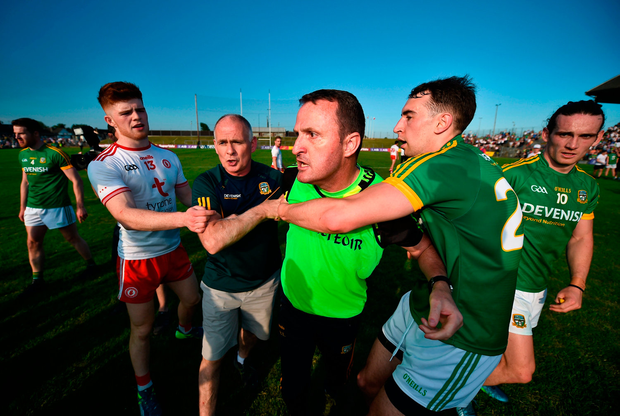 Meath manager Andy McEntee is restrained after confronting the referee. Photo by Stephen McCarthy/Sportsfile
