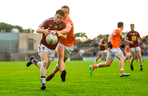 John Connellan of Westmeath is tackled by Aaron McKay of Armagh. Photo by Ramsey Cardy/Sportsfile