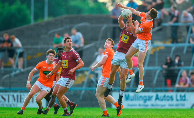Ger Egan of Westmeath in action against Connaire Mackin of Armagh. Photo by Ramsey Cardy/Sportsfile