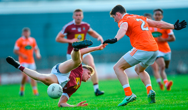Luke Loughlin of Westmeath in action against Patrick Burns of Armagh. Photo by Ramsey Cardy/Sportsfile