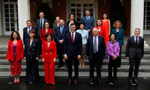 Spain's new Prime Minister Pedro Sanchez poses with new government members following their first cabinet meeting at the Moncloa Palace in Madrid, Spain. Photo: REUTERS/Susana Vera