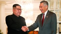 Kim Jong-un is greeted by Singapore premier Lee Hsien Loong. Photo: Reuters