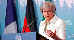 British Prime Minister Theresa May is facing growing unease on her party's backbenches over her handling of Brexit talks. Photo: Reuters