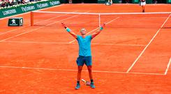 Rafael Nadal celebrates his 11th French Open title after defeating Austrian Dominic Thiem at Roland Garros yesterday. Photo by Clive Brunskill/Getty Images