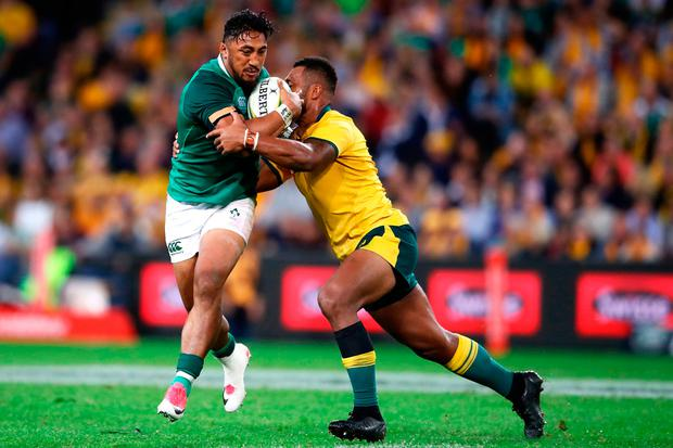 Bundee Aki of Ireland is tackled. Photo by Mark Kolbe/Getty Images