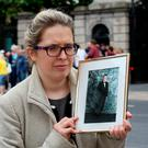 Catherine Power with a photo of her brother Tom. Picture: Tom Burke
