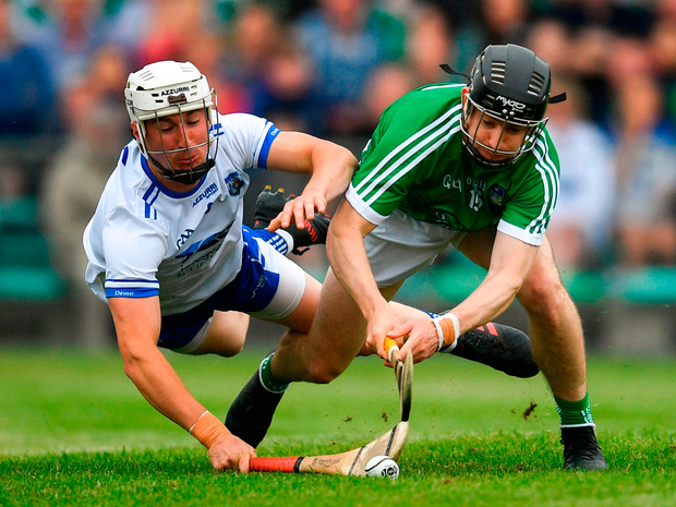 Graeme Mulcahy of Limerick shoots to score his side's second goal of the game despite the attention of Conor Gleeson of Waterford during the Munster GAA Hurling Senior Championship Round 4 match between Limerick and Waterford at the Gaelic Grounds in Limerick. Photo: Sportsfile